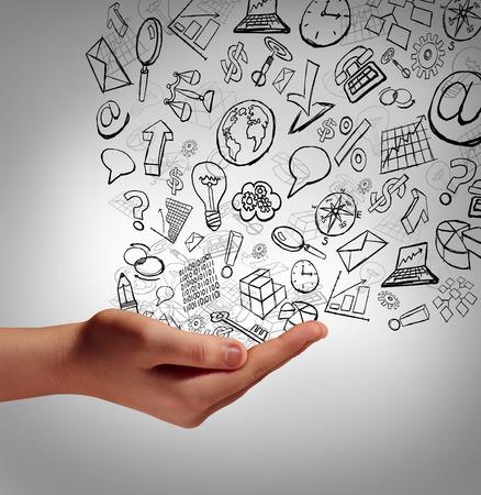 Marknadsföring kommunikationskoncept som en mänsklig hand som håller affärs ikoner sprider de finanial elementen uppåt som en symbol och metafor för marknadsföring reklam strategi eller företagsutbildning och utbildning på internet.