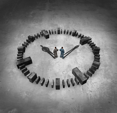 business symbols and metaphors: Business time concept as two businessmn standing in the middle of a sundail clock with their cast shadows as hour and minute hands as a symbol of corporate deadlines and managing a schedule for meeting appointments. Stock Photo