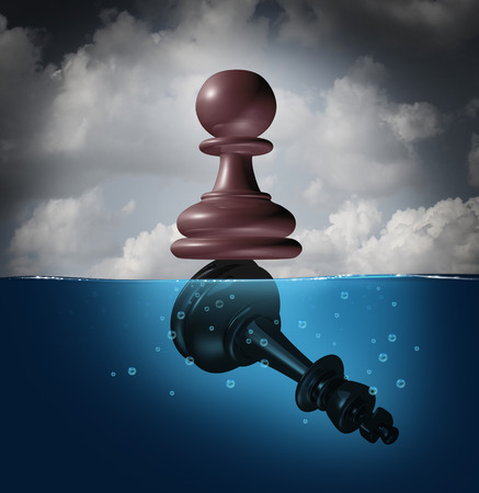Winner and champion success concept as a chess pawn piece standing on top of a drowning king as a business metaphor for victory and defeat.