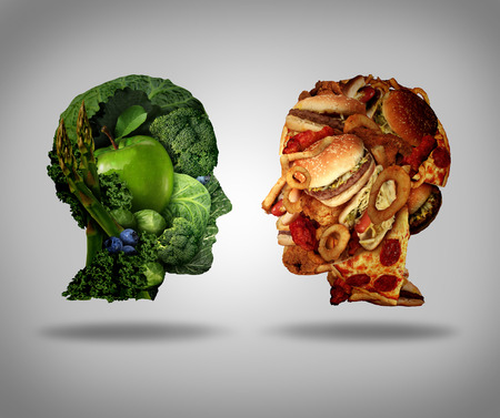 fast: Lifestyle choice and dilemma concept as a two human faces one made of fresh green vegetables and fruit and the other head shaped with greasy fast food as hamburgers and fried foods as a symbol of nutrition facts and healthy living issues.