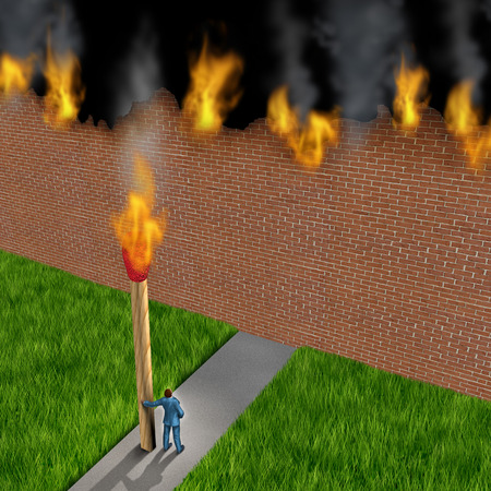 Escape concept as a businessman holding a giant ignited match burning down a brick wall made of paper as a success metaphor for avoiding fear and to destroy obstacles using clever strategy. photo