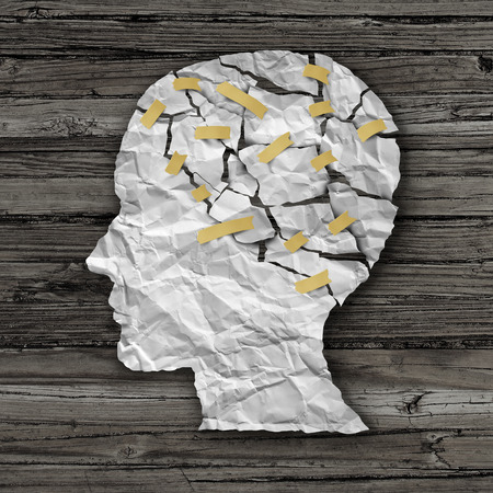 brain cancer: Brain disease therapy and mental health treatment concept as a sheet of torn crumpled white paper taped together shaped as a side profile of a human face on wood as a symbol for neurology surgery and medicine or psychological help. Stock Photo