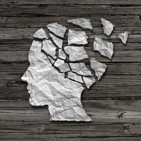 imbalance: Alzheimer patiënt geneeskundige geestelijke gezondheidszorg begrip als een blad van gescheurd verfrommeld wit papier in de vorm van een zijprofiel van een menselijk gezicht op een oude grungy hout achtergrond als een symbool voor neurologie en dementie problemen of geheugenverlies.