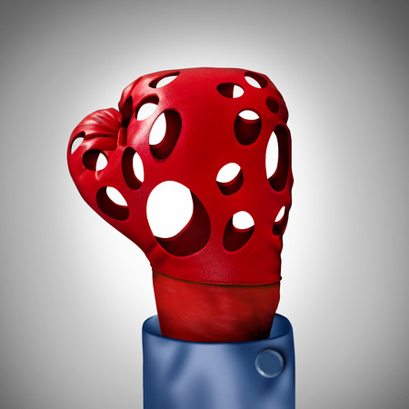 impotent: Competition problem and hollow promises business concept as a red boxing glove with empty holes as a failure metaphor for being not competitive and exhausted due to work office burnout or lack of financial funding and losing competitiveness.