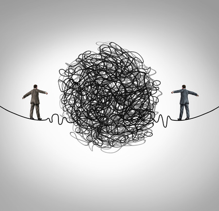 Partnership problem and business confrontation concept as two business people walking on a high wire tightrope with a tangled group of wire obstacle dividing the businessmen as a crisis metaphor for professional relationship stress.