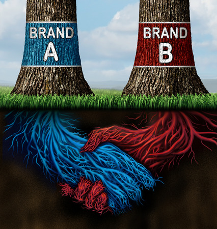 coming together: Business collusion concept as two trees representing companies with different market brands coming together secretively in a handshake as underground roots as a metaphor for market deception and fraudulent relationship.