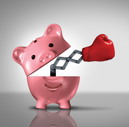 Budget power financial concept as an open ceramic piggy bank with an emerging punching boxing glove as a success metaphor in fighting for the best savings solutions and interest rates to manage consumer debt and spending. Archivio Fotografico