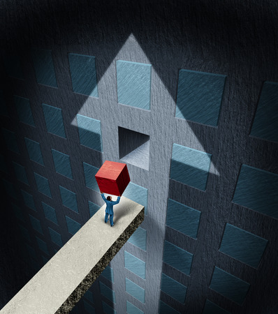 Financial success concept as a businessman lifting a heavy red cube to complete a wall puzzle shaped as an upwards arrow as a business wealth plan and profit strategy metaphor.