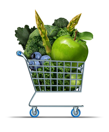 super market: Healthy shopping as a supermarket cart filled with green fresh vegetables as and fruit as a health food symbol for living well by buying market produce on a white background.