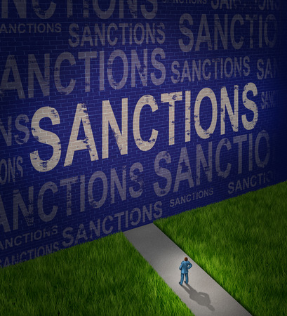 diplomatic: Economic sanctions as a global economy symbol for problems with political disputes affecting trade as a man standing in front of a brick wall with words as a metaphor for diplomatic challenges and failure resulting in government isolation.