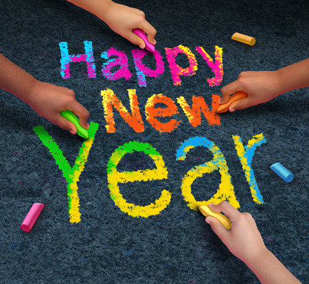 new year: Happy new year friends concept with a group of hands representing ethnic groups of young people holding chalk cooperating together as a diverse group celebrating the future. Stock Photo