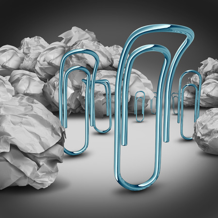 refused: Office downsizing concept as a group of sad depressed paper clips moving away from crumpled paper as a symbol and business metaphor for job cuts and industry lay offs of non essential or no longer useful workers.