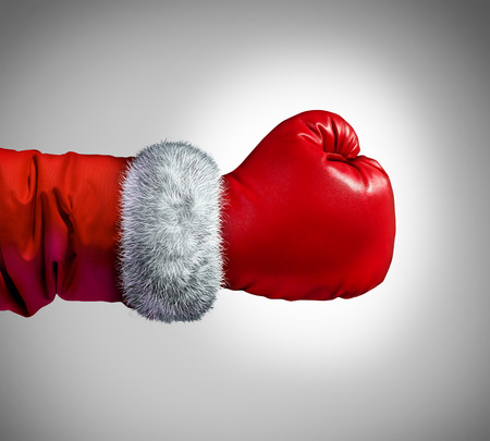to santa: Santa clause boxing glove concept as a holiday business concept for competing consumer shopping after christmas for sales and bargains..