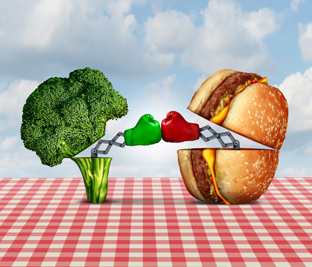 bad diet: Diet battle and food fight nutrition concept as a fresh healthy broccoli fighting an unhealthy cheese burger with boxing gloves punching each other. Stock Photo