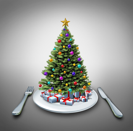 recipe decorated: Holiday dinner and winter celebration food recipe as a decorated pine christmas tree on a table setting with a plate fork and knife as a symbol of eating during the holidays. Stock Photo