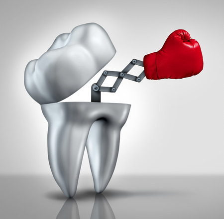 Fighting cavities and dental health care concept as an open molar tooth with a red boxing glove emerging to fight tooth decay as a hygiene symbol of dentistry and dentist services.