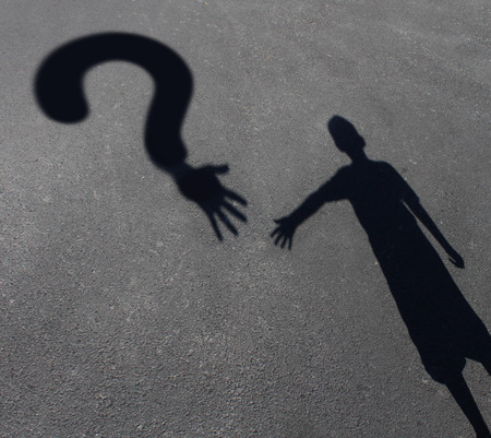 Child care question or childcare uncertainty concept as a cast shadow of a youth reaching out to a symbol for questions as a metaphor for solutions for helping children in need.