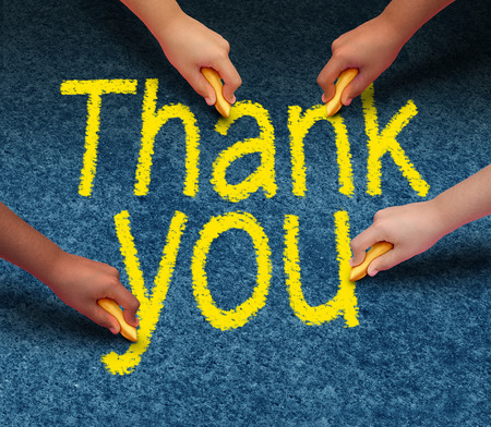 culturally: Thank you writing on street pavement by a group of culturally diverse people drawing the words of gratitude with chalk as a community support concept.