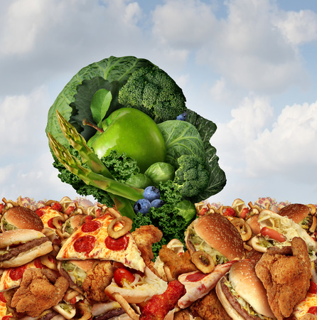 Drowning in fat concept as a human face made of fresh green vegetables and fruit struggling to survive from the ocean of greasy fast food and fried foods as a symbol of nutrition crisis. Stock Photo