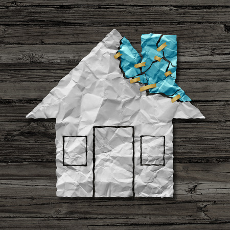repaired: Home repair concept and house improvement symbol as crumpled paper shaped as a residential structure with torn pieces as an icon for renovations and maintenance.