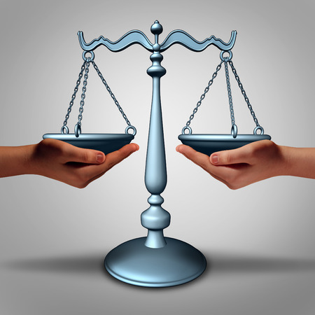 solicitor: Legal support and lawyer advice concept as two hands holding a justice scale as a metaphor and law symbol for court services and contract advice.