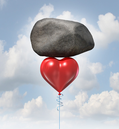 heavy heart: Power of love metaphor or heavy heart challenge concept as a red balloon shaped as the symbol for romance and relationships lifting up a huge rock.