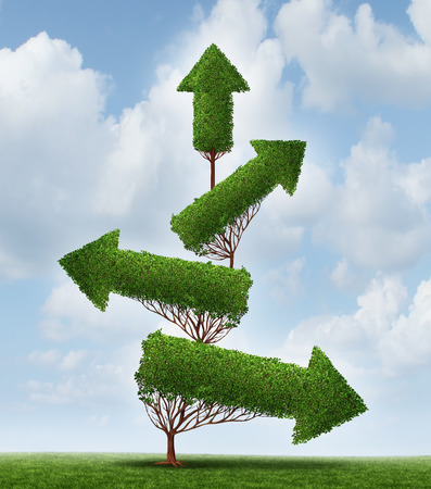 Recovery and success business concept as an arrow tree pointing downward gradually recovering with upward pointing branches as a symbol for financial and economic achievement. Banque d'images