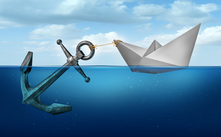 Determination concept business concept as a paper boat  in water pulling a heavy metal anchor as an independence and resolve symbol.