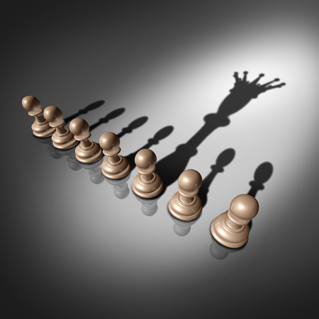 Leadership search and business recruitment concept as a group of pawn chess pieces and one individual standing out with a king crown cast shadow as a metaphor for the chosen one.