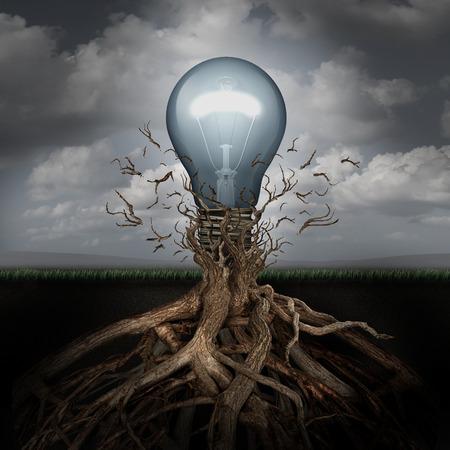 創造性と成功のメタファーとしての枝の拘束から自由に壊れて地下の根から出て新興電球としてアイデアの上昇の概念。 写真素材