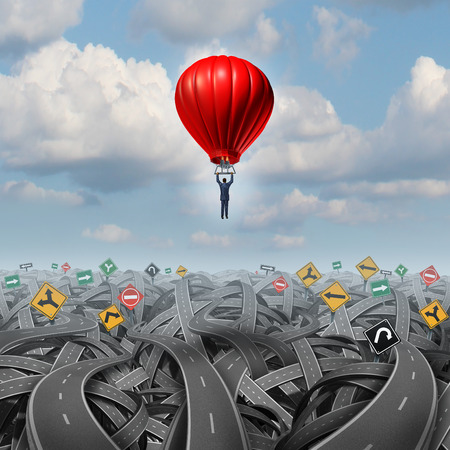 Easy way forward rise above confusion leadership concept with a businessman in a balloon flying and soaring over a complicated group of roads as a business metaphor of innovative creative thinking for success.