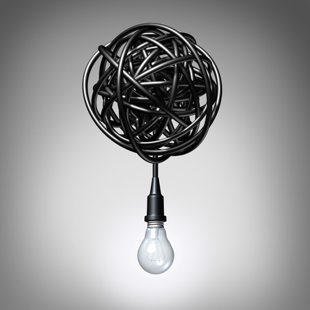 chaos: Creative advice concept as a lightbulb or light bulb hanging down from a tangled chaos of twisted electric cord as a success metaphor and creativity resolution symbol. Stock Photo