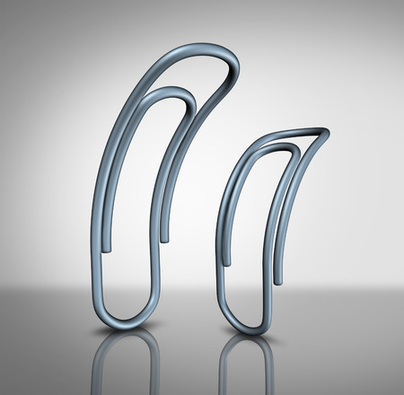 Office bullying and bullies in the workplace concept as two paperclips with one intimidating another as a corporate bully metaphor and worker management.
