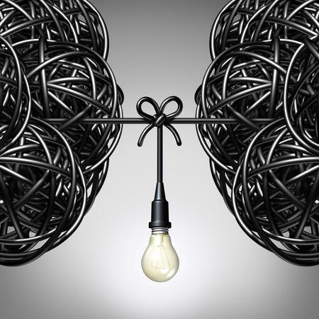 colaboracion: Ideas concepto de equipo y la colaboraci�n como dos grupos de cable el�ctrico enredado o alambre con una conexi�n bombilla atadas entre los socios como una met�fora del trabajo en equipo para el �xito.