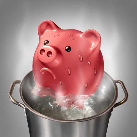 money problems: Financial heat business concept as a piggybank in a pot of hot boiling water as a symbol for money problems and budget savings stress and finance anxiety.