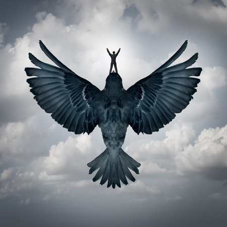 ascending: Success freedom business concept as a man riding an open wing bird flying upward as a symbol for reaching career goals or leadership vision.