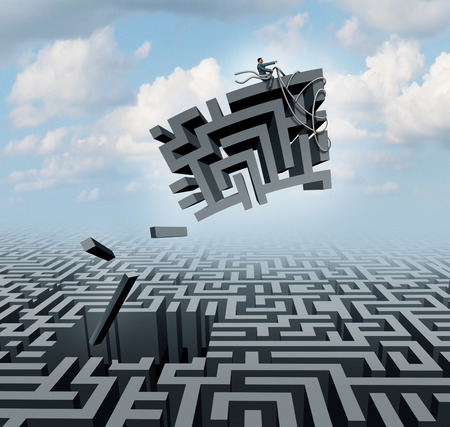 New thinking and empowerment concept as a businessman riding a chunk of a maze or labyrinth as a business or life success concept and solution symbol for finding the answer.