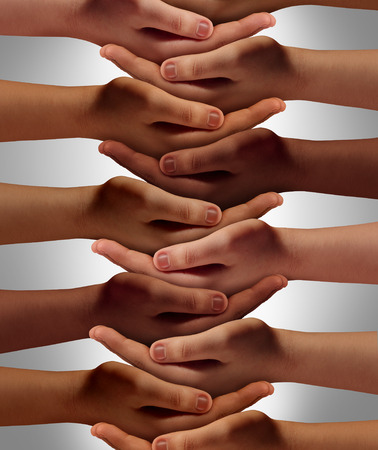 Support network concept and people power from a multicultural society working together with respect to help one another achieve community success as a group of connected hands holding each other. Stock Photo