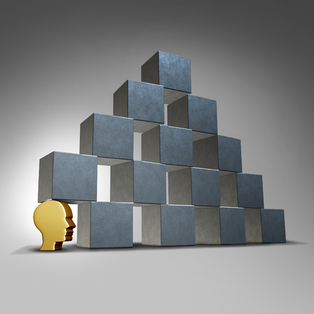 cornerstone: Essential services and crucial support concept as a head icon supporting a group of blocks in a pyramid formation as a symbol for being the cornerstone for an organization. Stock Photo