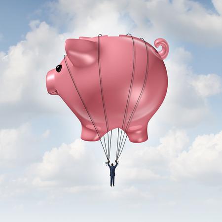 Concept de la liberté financière comme un ballon à air chaud de tirelire soulevant un homme d'affaires à succès comme la gestion de fortune et de conseil en investissement métaphore. Banque d'images