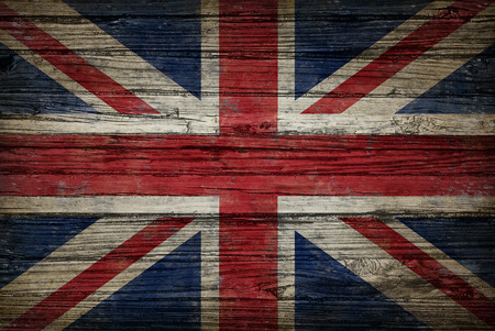 national cultures: Great Britain flag painted on old weathered,wood as an old vintage British and United Kingdom concept of a symbol of historical patriotism and English culture on an antique textured material.