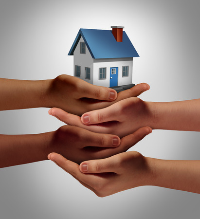 housing development: Community housing concept and neighbor support or neighborhood watch symbol as a connected group of diverse hands supporting and holding a family home as a metaphor for friendly residents.