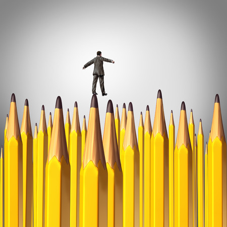 Creative decision risk concept as a person walking carefully through a background with a group of sharpened lead pencils as a symbol of the challenges of business planning. photo