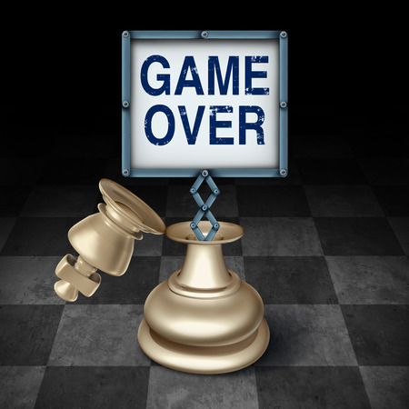 terminated: Game over business concept as an open king chess piece on a checkered board with a sign emerging with words representing the competitive metaphor and symbol for the end or termination as a winner or loser.