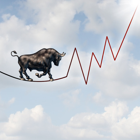 investing: Bull market risk financial concept as a heavy bullish beast walking on a high tightrope shaped as a stock market profit chart representing the investment danger ahead. Stock Photo