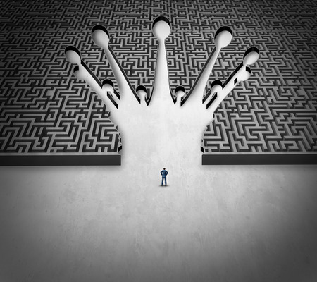 challenge: Leadership maze business concept as a person standing in front of a complicated labyrinth shaped as a king crown  Stock Photo