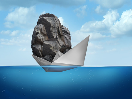 challenges: Impossible concept as a paper boat transporting a heavy rock boulder as a business symbol for overachieving and the power of determined potential to do things that are unbelievable. Stock Photo