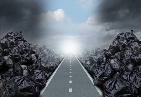 Garbage solution environmental concept as a straight road or clear path cutting through a background with garbage bags as a symbol for global waste management hope for the future.