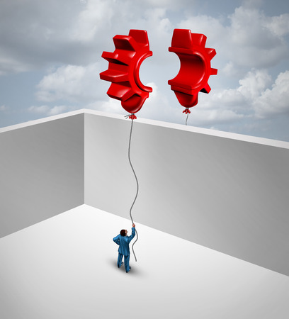 complete solution: Overcome business barriers as two partners separated by walls in a joint effort to merge two flying red balloons shaped as half a gear or cog as a symbol for trade success and global trade solutions. Stock Photo
