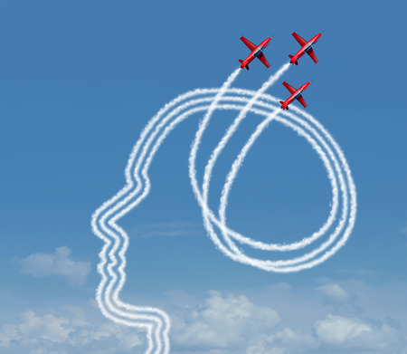 Personal achievement and career aspiration concept as a group of acrobatic jet airplanes performing an air show creating a human head shape for business vision success or learning potential metaphor. Banque d'images